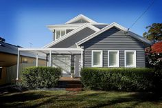 Did you know that Scyon weatherboards and cladding can be painted any colour you like? A Hamptons look is achieved here by using Dulux Western Myall with white, but it can also be achieved using blue or grey tones, or neutrals. Weatherboard Exterior, Grey Exterior, Exterior Cladding, House Paint Exterior, Exterior Design, Exterior Houses, Bungalow Exterior, Exterior Color Schemes, House Color Schemes
