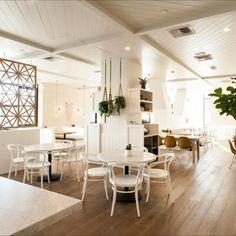 Cafe Gratitude Arts District. Beautiful photo from @eater_la, showcasing the stunning interior designed by @wendylhaworth. #cafegratitude #artsdistrict #design