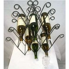 astrid wrought iron wall wine rack towel on PopScreen Bath Towel Racks, Towel Holder, Wrought Iron Wall Decor, Wine Rack Wall, Home Decor, Towel Racks, Decoration Home, Room Decor, Towel Hanger