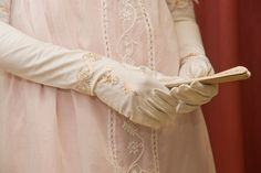 Regency cotton ball gloves trimmed with silk thread and metal spangles, made according to the extant ladies long gloves, c. 1790-1810, The Glove Collection Trust (Accession No: 23443 + A)