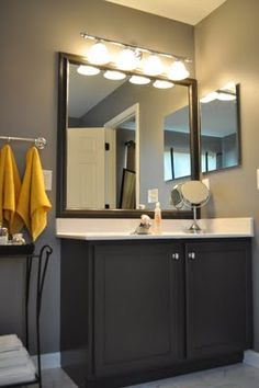 painting your builder grade bathroom cabinets. behr's evening hush