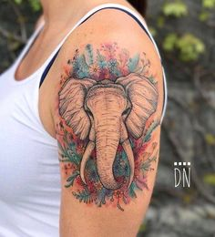 Elephant tattoo on the left upper arm. Tattoo Artist: Dino Nemec