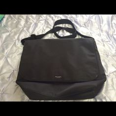 KATE SPADE MESSENGER/LAPTOP BAG KATE SPADE Nylon Classic Black Messenger Bag Measurements: 12 x 5 x 12 in. 2 wide internal pockets, 1 smaller inside pocket, 1 internal zip pocket. No visible signs of wear. Little use. Great for laptops and notebooks for the college fashionista. kate spade Bags Laptop Bags