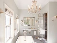 love this bathroom-  chandeliers make every room look more finished