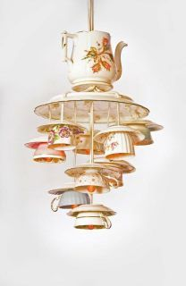 Unique chandelier with Moss Rose tea or coffee pot and small teacups for light globes topped with curved porcelain bowl.