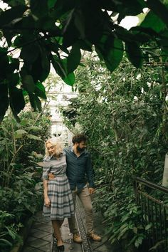 We love the idea of taking engagement photos in a greenhouse! | Imani Fine Art Photography