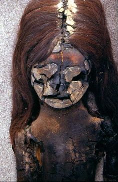 A naturally mummified Chinchorro child found in a Chilean desert.  Photograph  B. Arriaza