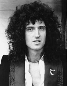 BRIAN MAY  .....    QUEEN ....    Not only the AMAZING guitarist from the best band of all time, he's a friggin' astrophysicist, and adorable to boot! .......  7/19/1947--
