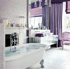 I love this elegant bathroom! The pop of purple is tasteful and calming (plus my favorite color)!