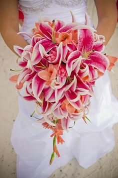 Stunning stargazer lily long bridal bouquets by Kelly's Wedding Flowers.