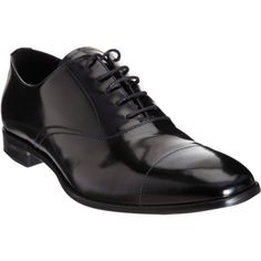 Christian's black Prada cap toe Balmoral shoes from chapter 68.