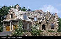 Architectural Designs House Plan 17527LV, a stunning French Country home. We love this photo! It shows someone who built it and made changes, in this case, the garage was turned 90 degrees. Plan Link: http://www.architecturaldesigns.com/house-plan-17527LV.asp