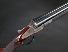 Shotgun:Double Barrel, 12 gauge L. Smith Grade Double Barrel Shotgun with EnglishStyle Engraving.