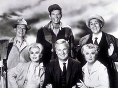 Green Acres.   Is the place to be...farm living is the life for me...land spread'in out so far and wide, keep Manhatten just give me that country side! dododododododo.