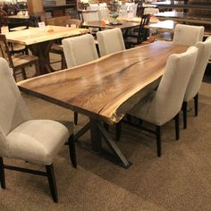 Walnut Live Edge SLAB Table Set. One solid walnut slab. Single Slab. Beautiful grain, color, and natural wood details. Custom designed metal base, complete with fully upholstered chairs for added class!
