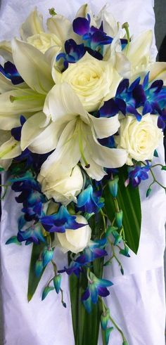 Wedding Bouquet   - blue / aqua / teal / white  - floral / beach / tropical  - orchids  - roses  - lilies  - green  - teardrop / trailing