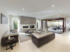 Luxurious lounge room by #boutiquemelb is accented by a modern fireplace #luxurious #loungeroom #love #Woodleaestate