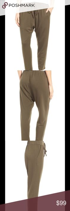 """NWT Eileen Fisher Stretch Tencel® Fleece Pants Stretch Tencel® Fleece Pants. color surplus. Drawstring-waist pants for lounging around (or really, anytime comfort matters most) are cut from a soft and cozy fleece knit. Petite: 22"""" inseam; 13"""" leg opening; 12 1/2"""" front rise; 15 1/2"""" back rise (size Medium P) Pull-on style/drawstring waist Front slant pockets 92% Tencel lyocell, 8% spandex Machine wash cold, tumble dry low Made in the USA of imported fabric Eileen Fisher Pants Track Pants…"""