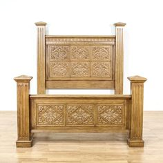 This bed frame is featured in a solid wood with a glossy light oak finish. This queen sized bed has fluted four poster columns, finial tops and intricate carved diamond floral leaf panels. Stunning statement piece perfect for accenting a bedroom! #americantraditional #beds #bedframe #sandiegovintage #vintagefurniture