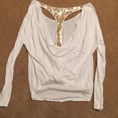 Victoria's Secret fancy top One of a kind Victoria's Secret top. Beautiful gold back details.main color is white, long sleeves. Only flaw is some jewels falling off on back, and discoloration of  the gold jewels from  washing.. Any questions ask! Make an offer Victoria's Secret Tops Tees - Long Sleeve