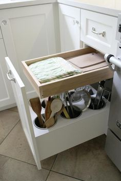 If you hate counter clutter: a pullout holds cooking tools and the little drawer has pot holders and towels. Clever idea.