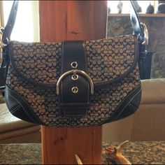 Coach Hobo bag - On Hold Until Wednesday 5-4. Magnetic closure. Two interior compartments and one zipper compartment. Great conditioning. Smoke-free environment. Coach Bags Mini Bags