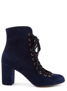Shop now. Chloé Miles Mid-Heel Suede Ankle Boots. Boots or shoes? Chloé's Miles lace-ups defy categorisation. With an almond toe and sturdy block mid-heel, the open foot is edged with brass eyelets and laces that fasten around the ankle for an adjustable fit. Inky blue suede makes a refreshing alternative to brown and black leather.