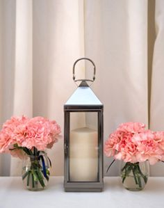 Pink Floral and Lantern Centerpiece - fitting for a castle?