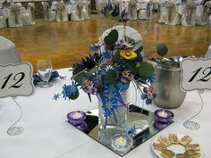 Gorgeous paper flower centerpieces with the Dr. Who theme going on!