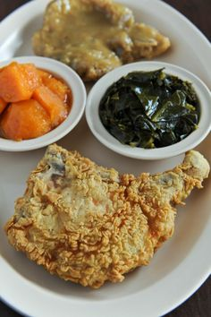 Fried and smothered pork chops with yams and collards from Busy Bee Cafe. #AJCWheretoEat #Atlanta #Food #Restaurants