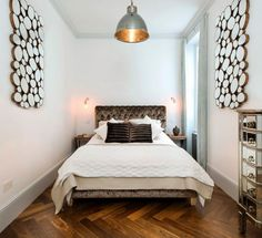 Narrow bedroom. Room for bed side tables, white bed linens and walls. Contrast pillows and headboard.