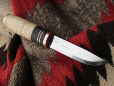 Copper, leather, and birch rehandled Mora knife