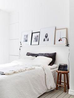 simple bedroom, white, wood, art