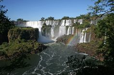 Iguazu Falls, one of top natural wonders of the world, straddles the border between Argentina and Brazil in the southern half of South America. Iguazu National Park, National Parks, Just Go, Places Around The World, Around The Worlds, Puerto Iguazu, Areas Protegidas, Reserva Natural, Iguazu Falls