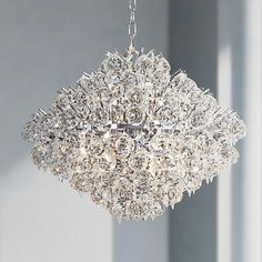 This crystal pendant light is full of glamour and sparkle and finished in a gleaming chrome for added shine.
