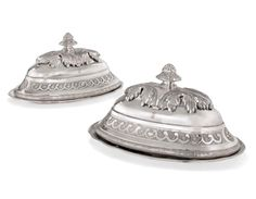 A PAIR OF SILVER MEAT-DISHES AND COVERS FROM THE MECKLENBURG-SCHWERIN SERVICE THE DISHES, MARK OF CARL GUSTAV HALLMUTH; THE COVERS WITH MAKER'S MARK PROBABLY 'ST' IN MONOGRAM, ALL ST PETERSBURG, 1774