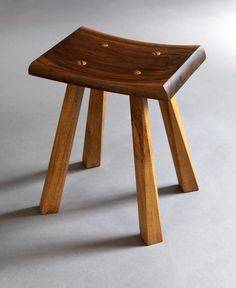 The contrasting color and wood between the walnut and oak is great but the leg angle and the cut make this a higher priced piece. Green Woodworking, Woodworking Furniture, Wood Furniture, Furniture Design, Wood Stool, Stool Chair, Woodworking Inspiration, Furniture Inspiration, Build A Farmhouse Table