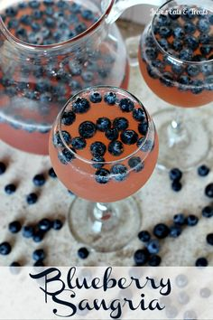 Blueberry Sangria ~ You won't be able to stop with just one of these fabulous drinks! A mixture of Chardonnay, Pink Lemonade, Brandy, Sprite and Blueberries will have you coming back for more! via www.julieseatsandtreats.com