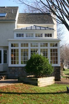 Window style for the sunroom - extra row of panes across the top