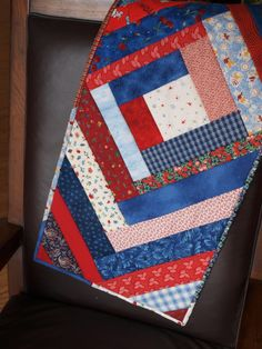 Make this beautiful quilted table runner with strips of fabric. It is fast and easy with the step by step guide provided.