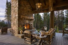 An outdoor fireplace design on your deck, patio or backyard living room instantly makes a perfect place for entertaining, creating a dramatic focal point. Outdoor Life, Outdoor Rooms, Outdoor Living, Rustic Outdoor, Rustic Deck, Outdoor Stone, Outdoor Seating, Home Design, Home Interior Design