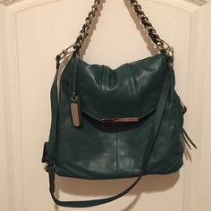 B. Makowsky handbag Beautiful Hunter Green, soft leather hand bag with chain detailed shoulder strap and detachable longer strap to wear as cross body.  Also has zippered sides on both sides of bag.  Like new.  Only used once. b. makowsky Bags Shoulder Bags