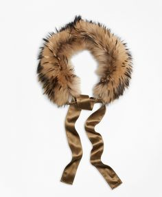 Our collar is crafted from dyed raccoon fur from Finland. Silk crepe ribbon. Professionally clean. Made in Italy.