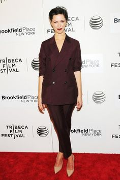 The Suit: How, And Why: Rebecca Hall showcases the new appeal of a classic double-breasted jacket, (and scores extra points for the deep plum shade of her gentlemanly suit).