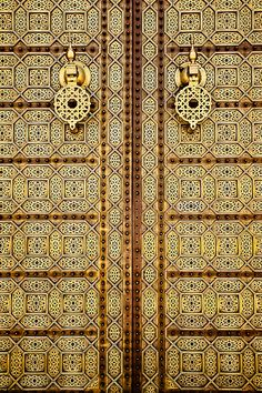 Imposing traditional Moroccan-style brass doors at the Mausoleum of Mohammed V.