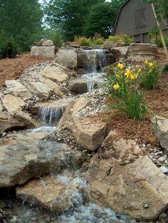 Falling stream water feature #TopekaLandscape