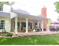 Image result for covered porch centered on back of house between low sloping roof