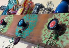 Such a fun and creative jewelry display! We love the colors used in this one.