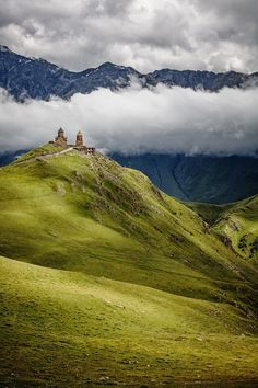 Gergeti Trinity church (Tsminda Sameba) is situated on Mount Kazbegi, in northern Georgia, North Caucasus Mountains. Photo by Adam Brill. Oh The Places You'll Go, Cool Places To Visit, Places To Travel, Caucasus Mountains, Georgia Country, Voyage Europe, Belle Photo, Wonders Of The World, Travel Inspiration