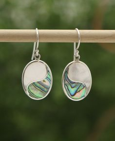 Sterling silver oval yin yang earrings made from beautiful mother of pearl and abalone shell. Handmade in Bali, Indonesia.